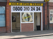 Goldstar Taxis sign